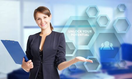 The concept of business, technology, the Internet and the network. A young entrepreneur working on a virtual screen of the future and sees the inscription: Unlock your potential
