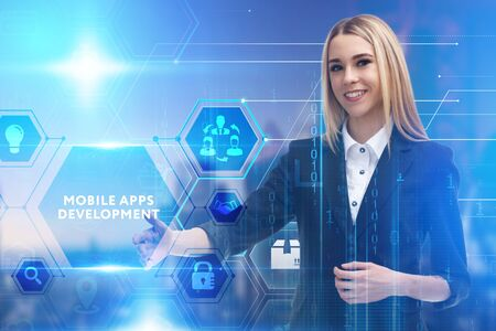 The concept of business, technology, the Internet and the network. A young entrepreneur working on a virtual screen of the future and sees the inscription: Mobile apps development Banco de Imagens