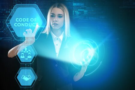 The concept of business, technology, the Internet and the network. A young entrepreneur working on a virtual screen of the future and sees the inscription: Code of conduct Фото со стока