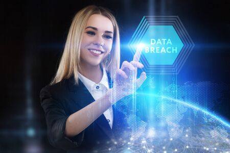 The concept of business, technology, the Internet and the network. A young entrepreneur working on a virtual screen of the future and sees the inscription: Data breach Banco de Imagens