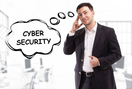 Business, technology, internet and network concept. The young businessman comes up with the keyword: Cyber security