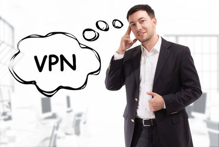 Business, technology, internet and network concept. The young businessman comes up with the keyword: VPN