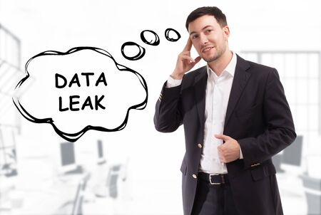 Business, technology, internet and network concept. The young businessman comes up with the keyword: Data leak