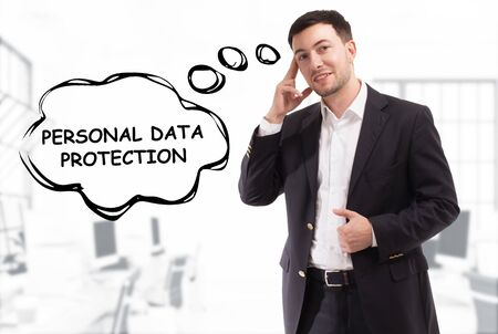 Business, technology, internet and network concept. The young businessman comes up with the keyword: Personal data protection