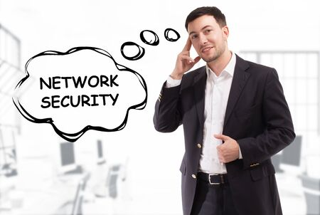 Business, technology, internet and network concept. The young businessman comes up with the keyword: Network security