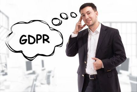 Business, technology, internet and network concept. The young businessman comes up with the keyword: GDPR