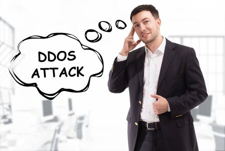 Business, technology, internet and network concept. The young businessman comes up with the keyword: Ddos attack