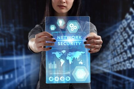 The concept of business, technology, the Internet and the network. A young entrepreneur working on a virtual screen of the future and sees the inscription: Network security Banco de Imagens