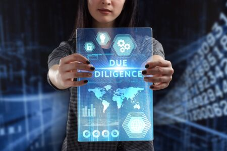 The concept of business, technology, the Internet and the network. A young entrepreneur working on a virtual screen of the future and sees the inscription: Due diligence