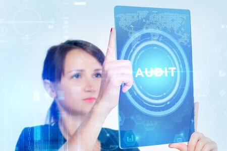 The concept of business, technology, the Internet and the network. A young entrepreneur working on a virtual screen of the future and sees the inscription: audit