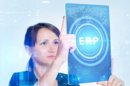 The concept of business, technology, the Internet and the network. A young entrepreneur working on a virtual screen of the future and sees the inscription: ERP 写真素材
