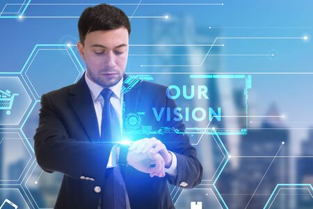 The concept of business, technology, the Internet and the network. A young entrepreneur working on a virtual screen of the future and sees the inscription: Our vision Zdjęcie Seryjne