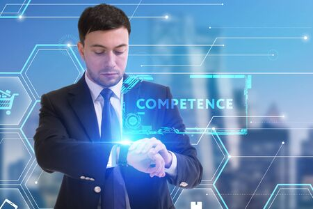 The concept of business, technology, the Internet and the network. A young entrepreneur working on a virtual screen of the future and sees the inscription: Competence