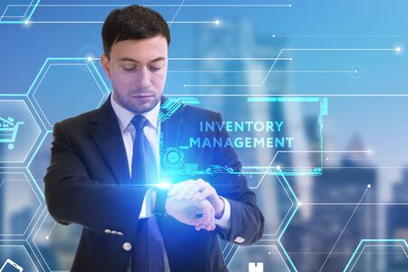 The concept of business, technology, the Internet and the network. A young entrepreneur working on a virtual screen of the future and sees the inscription: Inventory management Zdjęcie Seryjne