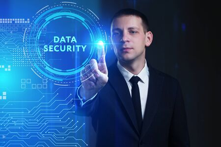 Business, Technology, Internet and network concept. Young businessman working on a virtual screen of the future and sees the inscription: Data security