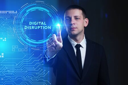 Business, Technology, Internet and network concept. Young businessman working on a virtual screen of the future and sees the inscription: digital disruption Stock fotó