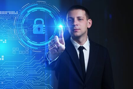 Business, Technology, Internet and network concept. Young businessman working on a virtual screen of the future and sees the inscription: lock