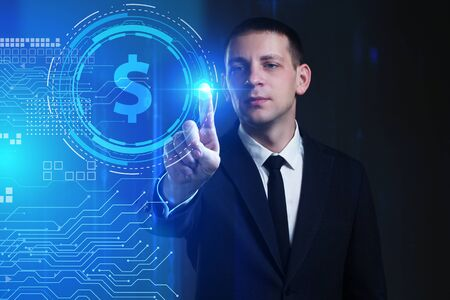 Business, Technology, Internet and network concept. Young businessman working on a virtual screen of the future and sees the inscription: dollar