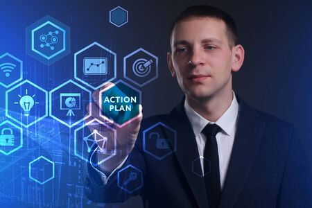 Business, Technology, Internet and network concept. Young businessman working on a virtual screen of the future and sees the inscription: Action plan