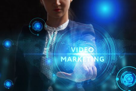 Business, Technology, Internet and network concept. Young businessman working on a virtual screen of the future and sees the inscription: Video marketing