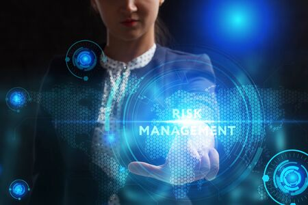 Business, Technology, Internet and network concept. Young businessman working on a virtual screen of the future and sees the inscription: Risk management Stock Photo