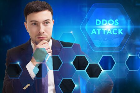 Business, Technology, Internet and network concept. Young businessman working on a virtual screen of the future and sees the inscription: Ddos attack Stock fotó