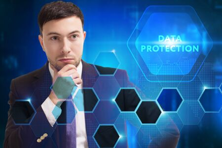 Business, Technology, Internet and network concept. Young businessman working on a virtual screen of the future and sees the inscription: Data protection Stock fotó