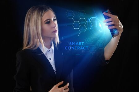 Business, Technology, Internet and network concept. Young businessman working on a virtual screen of the future and sees the inscription: Smart contract Banco de Imagens