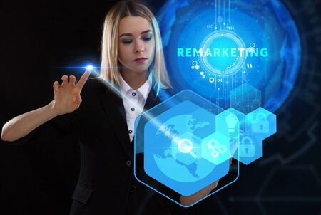Business, Technology, Internet and network concept. Young businessman working on a virtual screen of the future and sees the inscription: Remarketing Reklamní fotografie