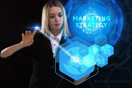 Business, Technology, Internet and network concept. Young businessman working on a virtual screen of the future and sees the inscription: marketing strategy