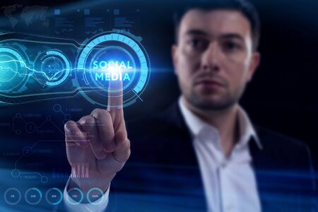 Business, Technology, Internet and network concept. Young businessman working on a virtual screen of the future and sees the inscription: Social media