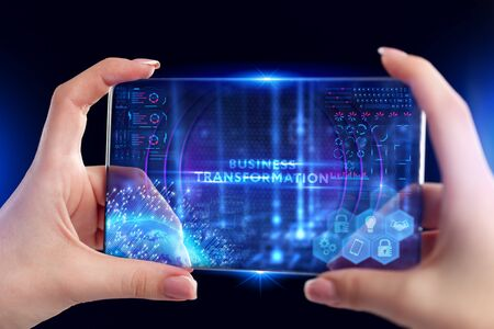 Business, Technology, Internet and network concept. Young businessman working on a virtual screen of the future and sees the inscription: Business transformation