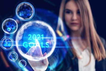 Business, Technology, Internet and network concept. Young businessman working on a virtual screen of the future and sees the inscription: 2021 goals