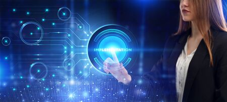 Business, Technology, Internet and network concept. Young businessman working on a virtual screen of the future and sees the inscription: Implementation Standard-Bild