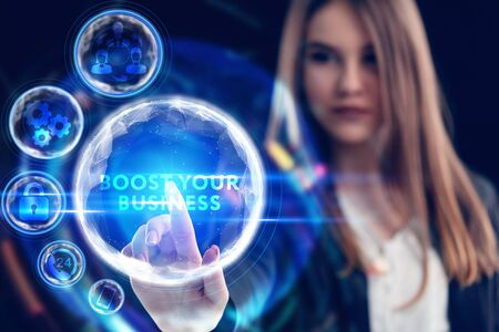 Business, Technology, Internet and network concept. Young businessman working on a virtual screen of the future and sees the inscription: Boost your business Reklamní fotografie