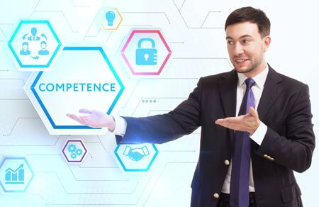 Business, Technology, Internet and network concept. Young businessman working on a virtual screen of the future and sees the inscription: Competence Zdjęcie Seryjne