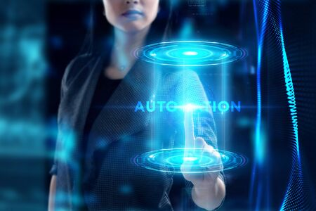 Business, Technology, Internet and network concept. Young businessman working on a virtual screen of the future and sees the inscription: Automation