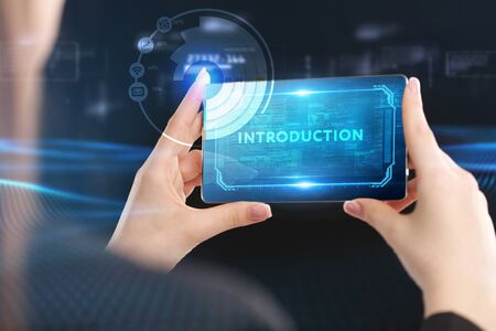 Business, Technology, Internet and network concept. Young businessman working on a virtual screen of the future and sees the inscription: Introduction