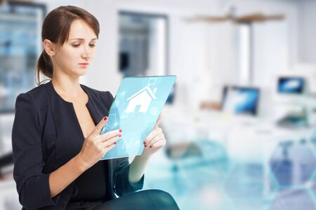 Business, Technology, Internet and network concept. Young businesswoman working on a virtual screen of the future Stock fotó