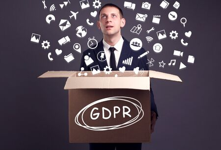 Business, technology, internet and network concept. A young businessman collects information to become successful: GDPR