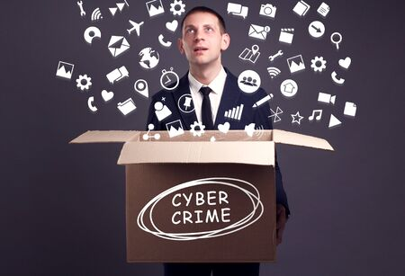 Business, technology, internet and network concept. A young businessman collects information to become successful: Cyber crime Фото со стока