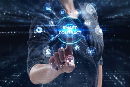 Business, Technology, Internet and network concept. Young businessman working on a virtual screen of the future and sees the inscription: Smart contract Stok Fotoğraf