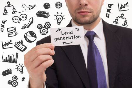 Business, technology, internet and network concept. Young businessman thinks over the steps for successful growth: Lead generation 스톡 콘텐츠