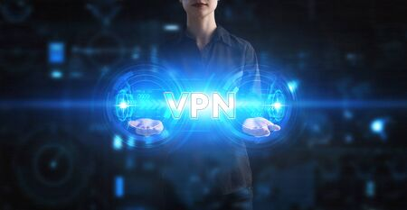 Business, Technology, Internet and network concept. Young businessman working on a virtual screen of the future and sees the inscription: VPN Foto de archivo - 150124709