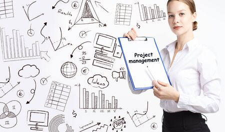 Business, technology, internet and network concept. Young businessman thinks over the steps for successful growth: Project management