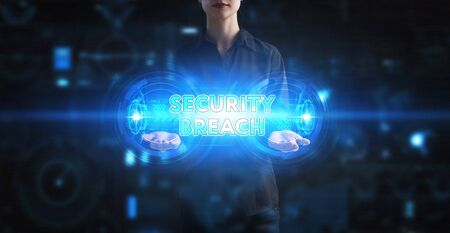 Business, Technology, Internet and network concept. Young businessman working on a virtual screen of the future and sees the inscription: Security breach Фото со стока