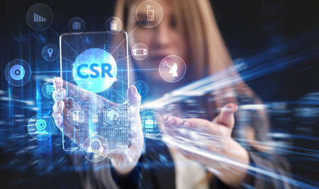 Business, Technology, Internet and network concept. Young businessman working on a virtual screen of the future and sees the inscription: CSR