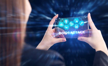 Business, Technology, Internet and network concept. Young businessman working on a virtual screen of the future and sees the inscription: Ddos attack Archivio Fotografico
