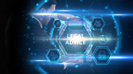 Business, Technology, Internet and network concept. Young businessman working on a virtual screen of the future and sees the inscription: Legal advice Imagens
