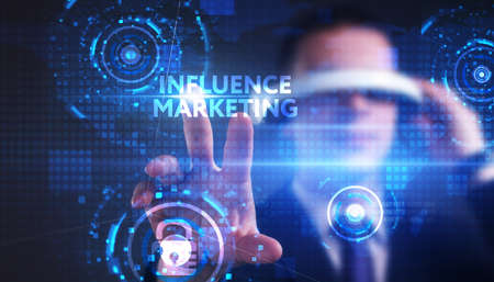 Business, technology, internet and network concept. Young businessman thinks over the steps for successful growth: Influence marketing Stock Photo